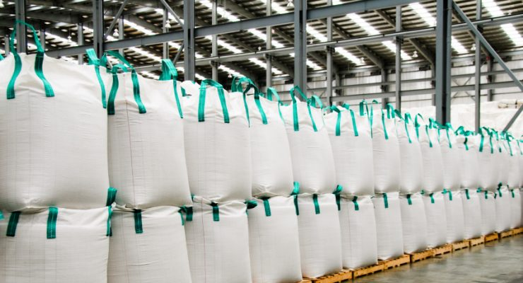 Huge sacks of sugar in a warehouse.